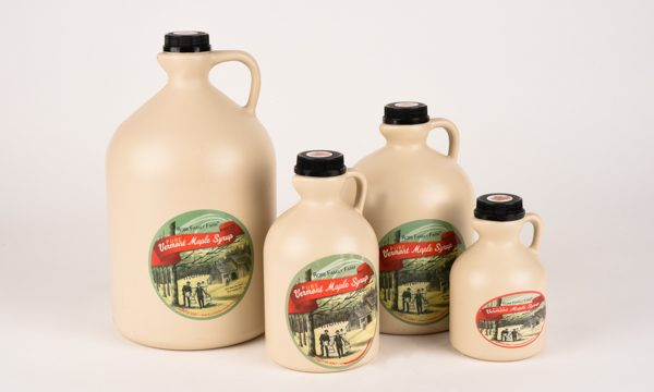 maple syrup in plastic jugs