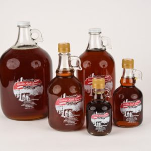 maple syrup in glass jugs