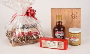 Brattleboro box contains grafton village cheese, maple spread, vermont maple syrup and a cutting board