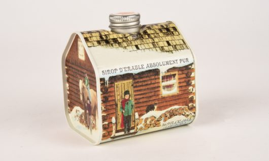 vermont maple syrup in a log cabin tin