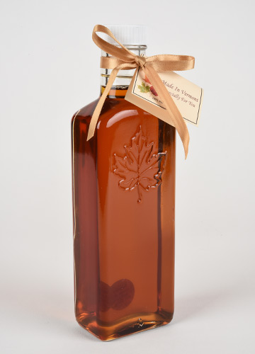 Vermont Maple syrup in emossed maple leaf bottle