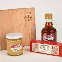Gift box with cutting board and maple syrup and cheese